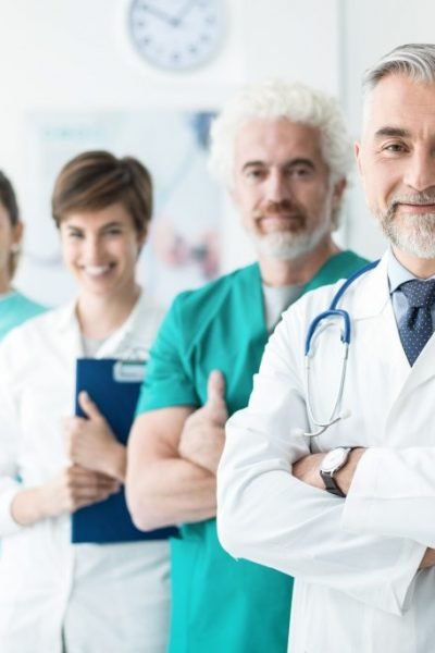Confident doctors posing at the hospital