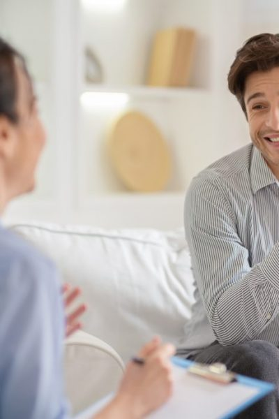 Thankful man sharing his plans with psychotherapist